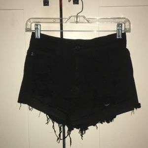 ripped black high-waisted shorts